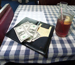 A 'tip' for food servers: Encourage separate checks at large tables to get a bigger tip.