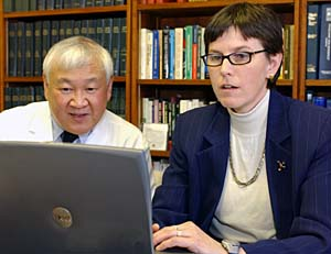 Carol S. North, M.D., professor of psychiatry, prepares interview material for the World Trade Center survival study with Barry Hong, Ph.D., professor of psychology in psychiatry and associate professor of medicine.