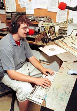 Sophomore Adam Aigner-Treworgy works the controls during his show on KWUR 90.3 FM. He is one of about 60 disc jockeys who work at the station, located in the basement of the Women's Building.