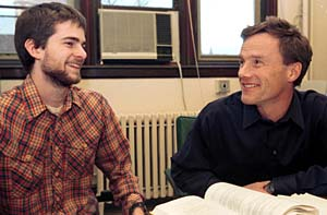 John E. McCarthy, Ph.D. (right), professor of mathematics in Arts & Sciences, and Greg Knese, a second-year mathematics graduate student, share a laugh in McCarthy's Cupples I Hall office.