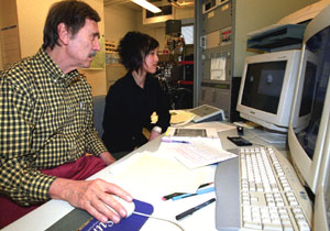 Ernst K. Zinner, Ph.D., research professor of physics and of earth and planetary sciences, and Ann Nguyen, a doctoral student in earth and planetary sciences, study a graphite grain in the NanoSIMS (Secondary Ion Mass Spectrometer) lab.