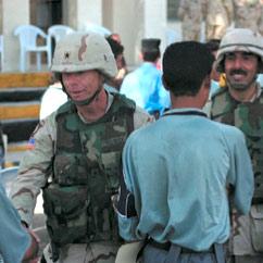 A U.S. Army brigadier general congratulates the graduates of the new police academy in Sin'Jar.