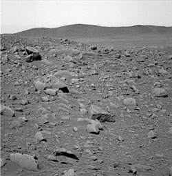 On to Columbia Hills (background).  Rover Spirit is wrapping up its tasks at Crater Bonneville.
