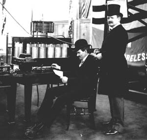 Lee DeForest (seated) sending wireless telegraph message from theLouisiana Purchase Exposition. Photograph from 1904.