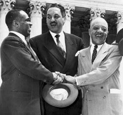 Thurgood Marshall (center) with George E.C. Hayes and James Nabri celebrating the historic Brown v. Board of Education Supreme Court decision.