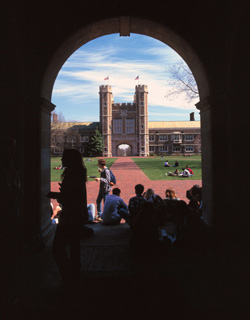 A view of Brookings Hall, west facade, and students in the Brookings Quadrangle