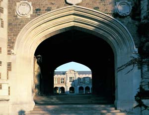 East facade of Brookings Archway with Ridgeley Hall and the Quad visible through the Archway.