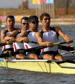 Student Steve Warner (front) and his rowing team compete in the 2004 Olympic Games. The crew finished ninth in the second finals race after a week-long regatta.