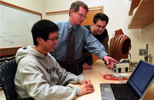 Professor Yoram Rudy (center), with Ph.D. student Yong Wang (left) and post-doctroal fellow Leonid Livshitz (right), with their ECGI system on a mannequin, comment on the cardiac data.