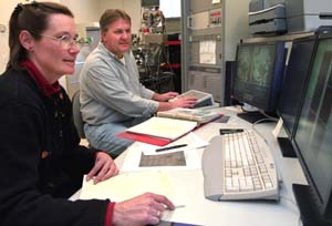 Christine Floss, Ph.D., and Frank Stadermann, Ph.D., examine data on the NanoSIMS in Compton Hall.  The husband-wife team contributed to the discovery of a space phenomenon, with results being published in the Jan. 14, 2005 issue of *Science*.  That publication marks  the fifth one to appear in *Science* involving NanoSIMS discoveries since 2001.