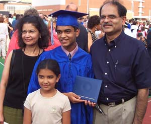 Shalini Shenoy, husband Surendra Shenoy, son Ashish and daughter Neeti at Ashish's high-school graduation last year.