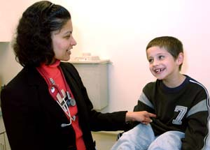 Shalini Shenoy gives patient Austin Beck, 5, a playful jab.