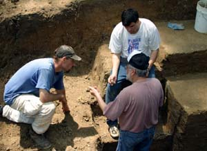 T.R. Kidder, Ph.D. (top right), professor of anthropology in Arts & Sciences, discusses the stratigraphy of Poverty Point's Mound A with Anthony Ortmann (left), a doctoral student from Tulane University, and Jon Gibson, Ph.D., professor of anthropology at the University of Louisiana at Lafayette.
