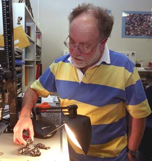 Randy Korotev, research associate professor of earth and planetary science, examines fragments of the Sikhote-Alin iron meteorite that fell in Siberia in 1947. The sample is the real McCoy, but Korotev regularly receives samples from meteorite enthusiasts that are wrong McKongs. Mistakenly identifed meteorites have the quaint moniker of meteorwrongs.