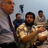 Ibrahim Al Hoqail (right), dean of the medical college at King Fahad Medical City, asks a question of instructor Stuart Boxerman (left), in statistics class at the Washington University School of Medicine.