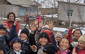 Richa Dhanju (left, rear) plays with a group of schoolchildren on her way to visit the remote village of Kung Elek in Kyrgyzstan.