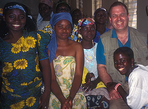 L. Lewis Wall, M.D., D.Phil., with fistula patients at Evangel Hospital, Jos, Nigeria. African women marry young, and many are unable to deliver their babies safely because their birth canals are not fully developed. During obstructed labor they may develop a fistula, an abnormal opening between the bladder and vagina that develops because their pelvis tissue has been crushed. Wall has traveled to Africa many times to perform surgery to repair the fistulas.