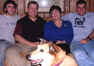 The Walls (from left), son Tom, Lewis, Helen, son Jimmy and family dog Sandy, relax in their Creve Coeur, Mo., home.