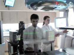 Parag Parikh and Kristen Lechleiter set up the 4D Phantom developed at Washington University School of Medicine to simulate the motion of tumors in the lung.