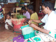 Women from Mahabo Village in Madagascar weaving baskets for the Blessing Basket Project.