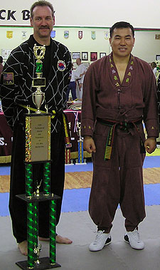 Richard K. Wilson (left) with Grandmaster Y.S. Rho, Wilson's Tae Kwan Do instructor. Wilson recently tested for and received his fifth-degree black belt.