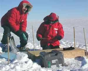 Douglas Wiens (left) and a colleague ready equipment to emplace seismographs in Antarctica during a 2001 expedition.  Data gathered for this project, called TAMSEIS, provided evidence that an Antarctic ice stream radiates seismic waves twice daily that are equivalent to a magnitude 7 earthquake.