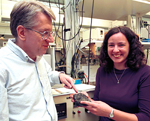 Bruce Fegley, Jr.,  Ph.D., professor of earth and planetary sciences in Arts & Sciences, and Laura Schaefer, resarch assistant in the Planetary Chemistry Laboratory, with a chunk of galena, or lead sulfite.  The researchers have determined that the feature on Venus that looks like snow is composed of both lead and bismuth sulfides, settling a long-time controversy in the planetary community.