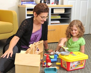 Joan Luby and girl playing