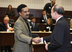 Chancellor Mark S. Wrighton (right) greets Seethu Seetharaman, PhD, at the start of the ceremony installing him as the W. Patrick McGinnis Professor of Marketing at Olin Business School.