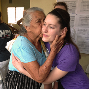 Physical therapy student Leslie Wallace gets a kiss from a Guatemalan woman who was grateful for the students' visit to her village.