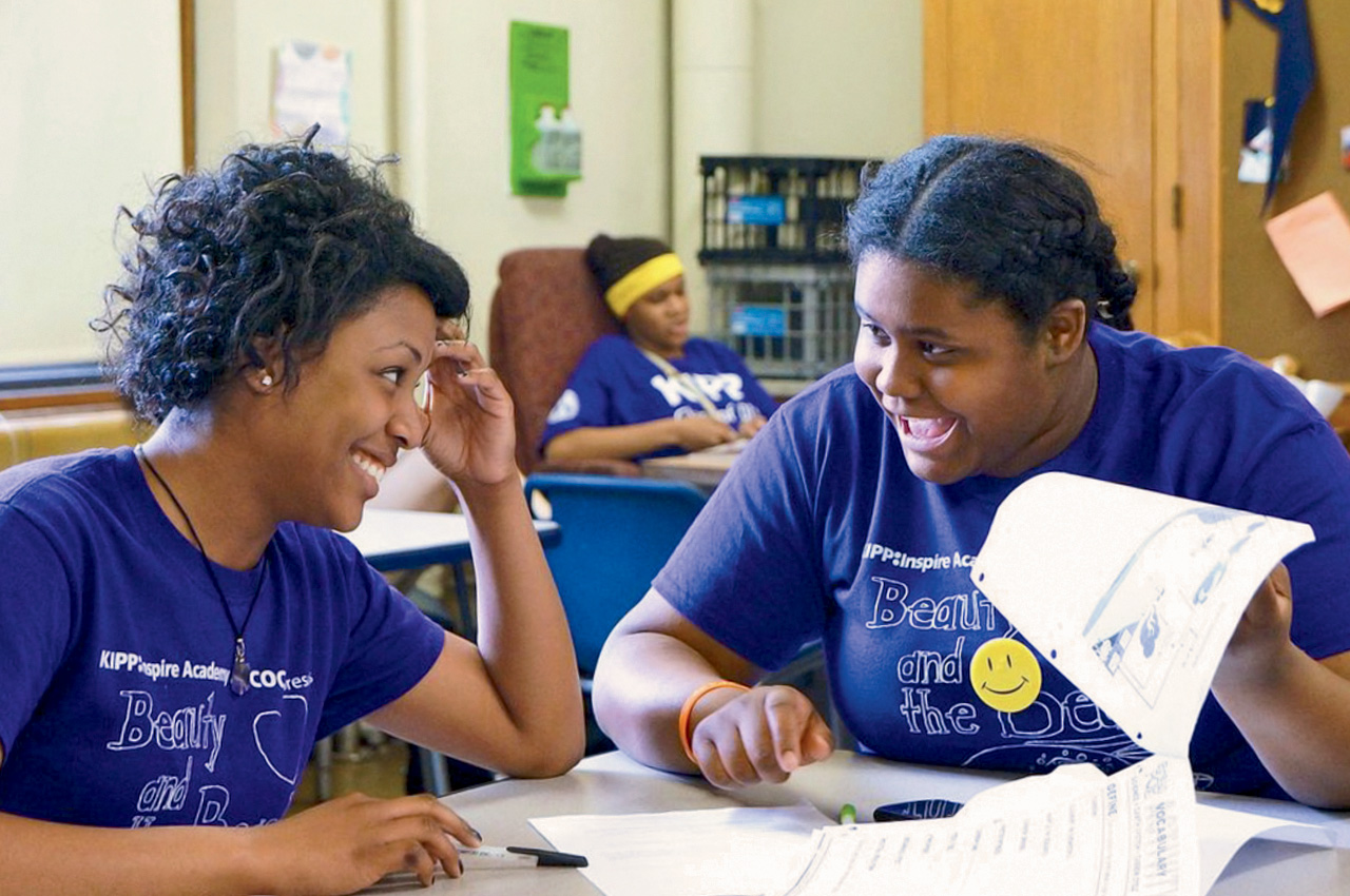 Da'Nyjia Partee (left) and Phallen Briggs graduated from the WUSTL-sponsored KIPP Inspire Academy in June 2013.