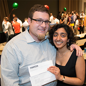 ​Washington University MD/PhD student Radhika Jagannathan (right) received two surprises at Match Day on Friday, March 21. First, she learned she will be going to NewYork-Presbyterian/Weill Cornell Medical Center for her residency. Then, moments later, she received an unexpected marriage proposal from her boyfriend, Tom Wilson.