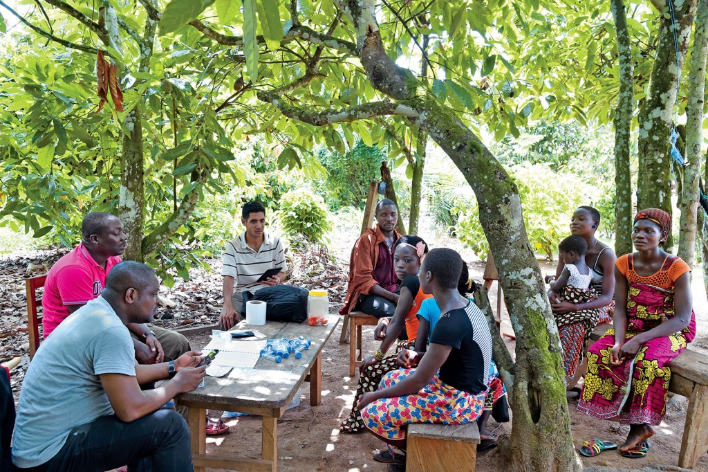 For the DOLF Project, workers from local ministries of health carry out the bulk of tasks and interactions with the community. University researchers and staff — such as Joshua Bogus (center), MPH, DOLF's global health project manager for operations — train and advise in sample collection, laboratory testing and drug administration. (Photo: Issouf Sanogo/Agence France-Presse)