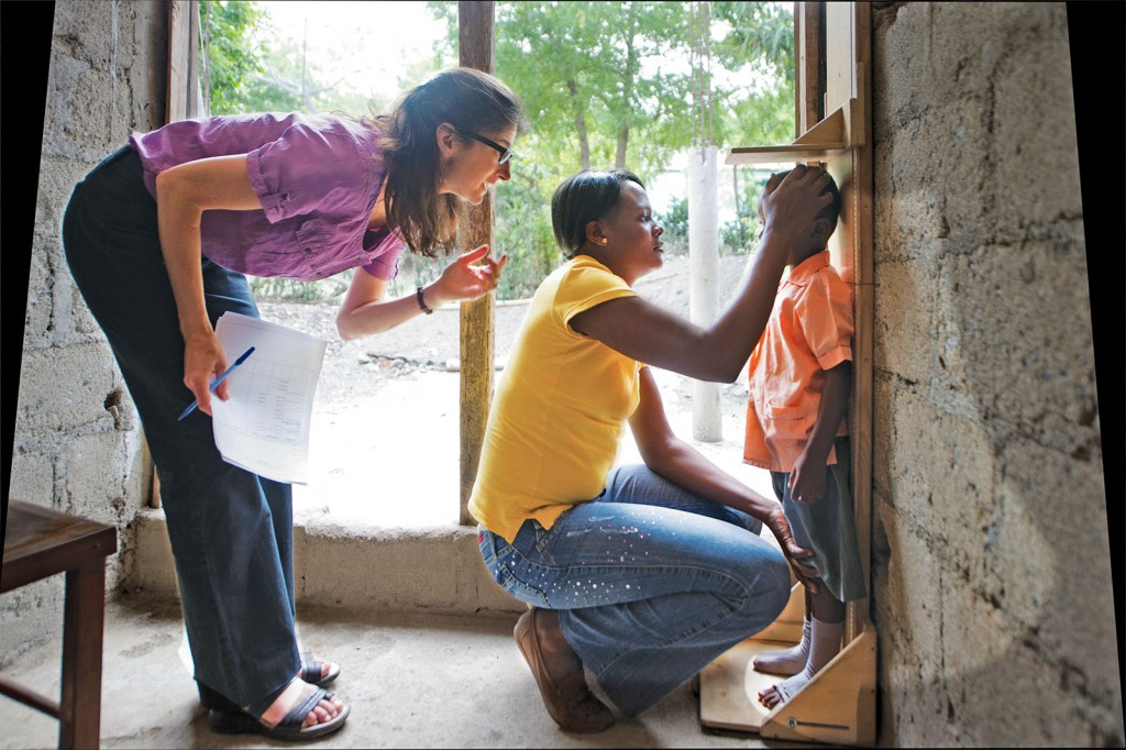 Lora Iannotti (left), PhD, assistant professor at the Brown School, has worked in Haiti for 25 years. She collaborates with in-country partners, such as Saminetha Joseph (center), on public health and prevention research projects at the nexus of poverty, micronutrient deficiency and infectious disease. (Photo: Hector Retamal/Agence France-Presse)
