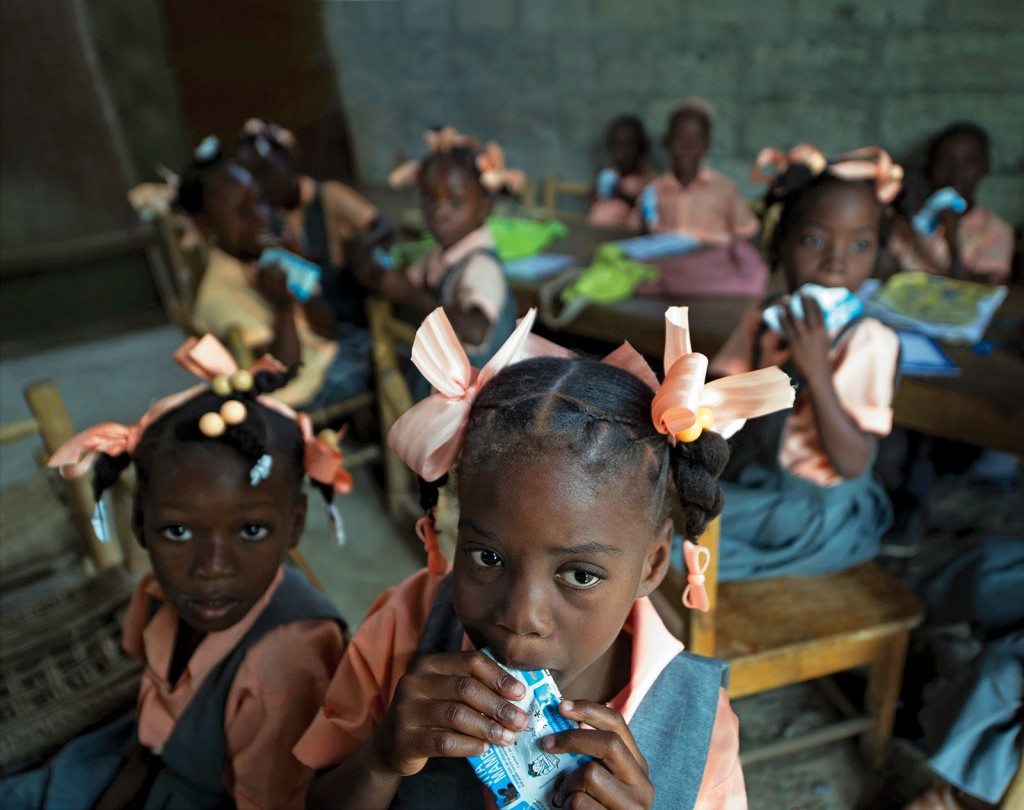 In Haiti, Brown School Assistant Professor Lora Iannotti, PhD, also partners with Patricia Wolff, MD, professor emerita of clinical pediatrics at the medical school, to develop and distribute Vita Mamba, a fortified snack for impoverished school-age children. Research shows significant improvements in the body composition of children receiving the supplemental snack. (Photo: Hector Retamal/Agence France-Presse)