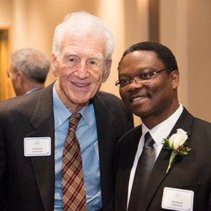 Washington University Chancellor Emeritus William H. Danforth (left) visits with Samuel Achilefu, PhD, after Achilefu received the St. Louis Award on Wednesday, Jan. 14, on the Medical Campus. The honor recognizes area residents whose achievements reflect positively on the community. Danforth received the honor in 2012.