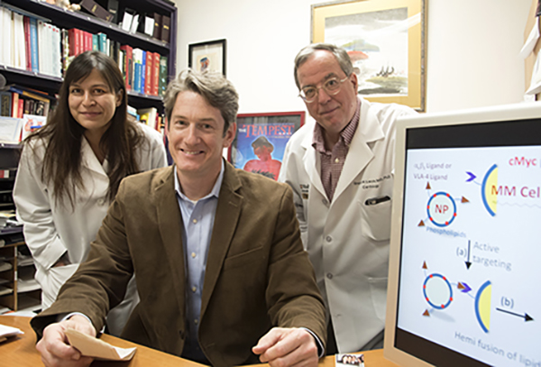 Researchers at Washington University School of Medicine in St. Louis have developed a nanotherapy that is effective in treating mice with multiple myeloma, a cancer of bone marrow immune cells. From left are first author Deepti Sood Gupta, PhD, and co-senior authors Michael H. Tomasson, MD, and Gregory M. Lanza, MD, PhD. Photo: Robert Boston