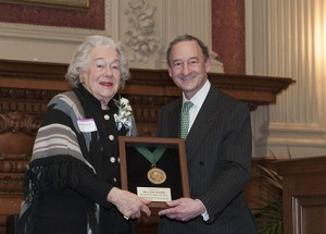 Mary Dell Olin Pritzlaff and Chancellor Mark S. Wrighton attend a Spencer T. Olin professorship installation in Holmes Lounge in 2012.