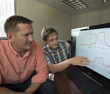 Brian N. Finck, PhD (left), and Kyle S. McCommis, PhD, analyze data showing it's possible to reduce blood sugar levels in people with diabetes by lowering glucose production in the liver.