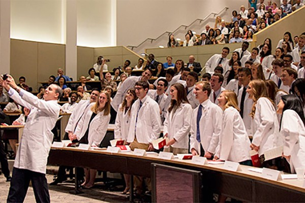 Medical students receive white coats, takeoath