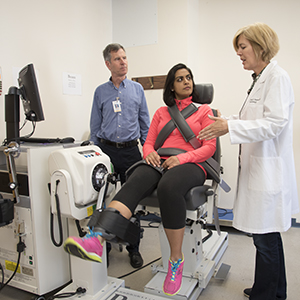 Cardiology fellow Nishtha Sodhi, MD, (center) demonstrates equipment used to measure muscle power. A study co-authored by Andrew Coggan, PhD, (left) and Linda Peterson, MD, showed that drinking concentrated beet juice boosts muscle power in patients with heart failure.