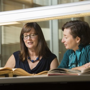 Rebecca Messbarger (left) and Corinna Treitel in the Kenneth and Nancy Kranzberg Art & Architecture Library.