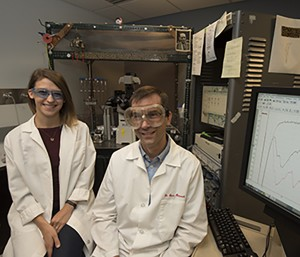 Washington University School of Medicine researchers Courtney Sobieski (left) and Steven Mennerick, PhD, found, in culture, that without cells called astrocytes, neurons send signals to one another more slowly. That slowdown could interfere with neuronal development and contribute to conditions linked to communication between neurons. (Photo: Robert Boston)