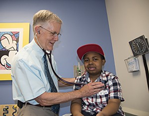 Robert Strunk, MD, examines LeBron Reed, a patient with asthma. Strunk, of Washington University School of Medicine in St. Louis, led a study showing the importance of children with asthma maintaining healthy weight as they grow into young adults. Photo: Robert J. Boston