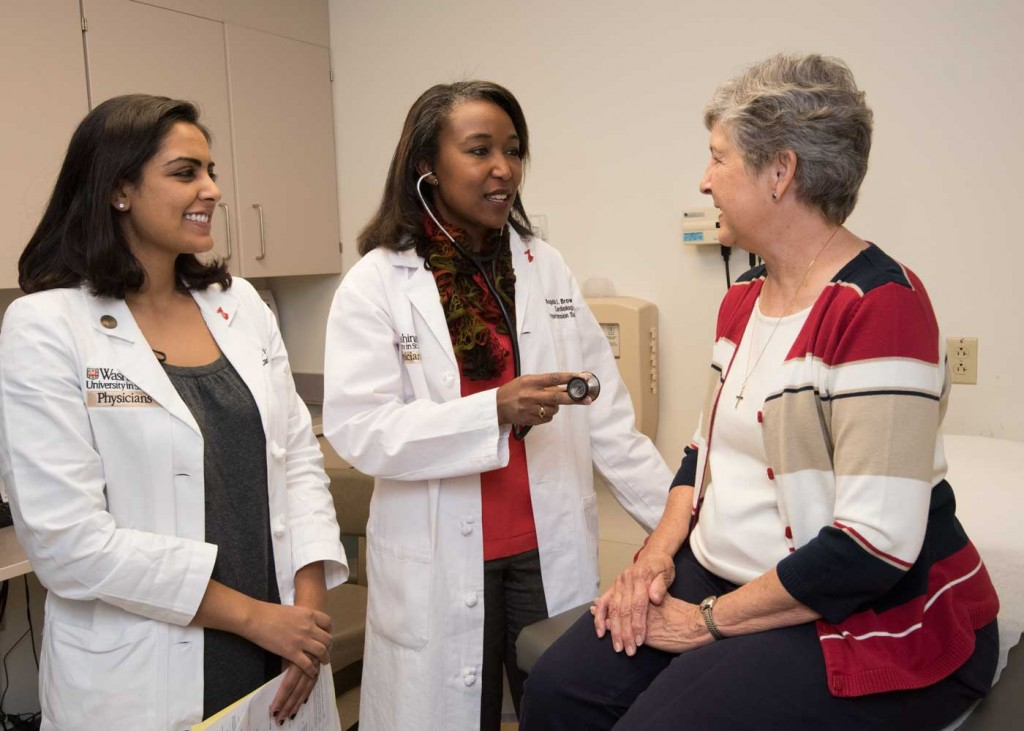 Angela L. Brown, MD, (center) runs the Hypertension Clinic at Washington University. Brown helps Karen Carriker (right) and other patients control high blood pressure. She also provides training for health-care professionals, such as cardiology fellow Nishtha Sodhi, MD (left), in how to care for patients with hypertension.