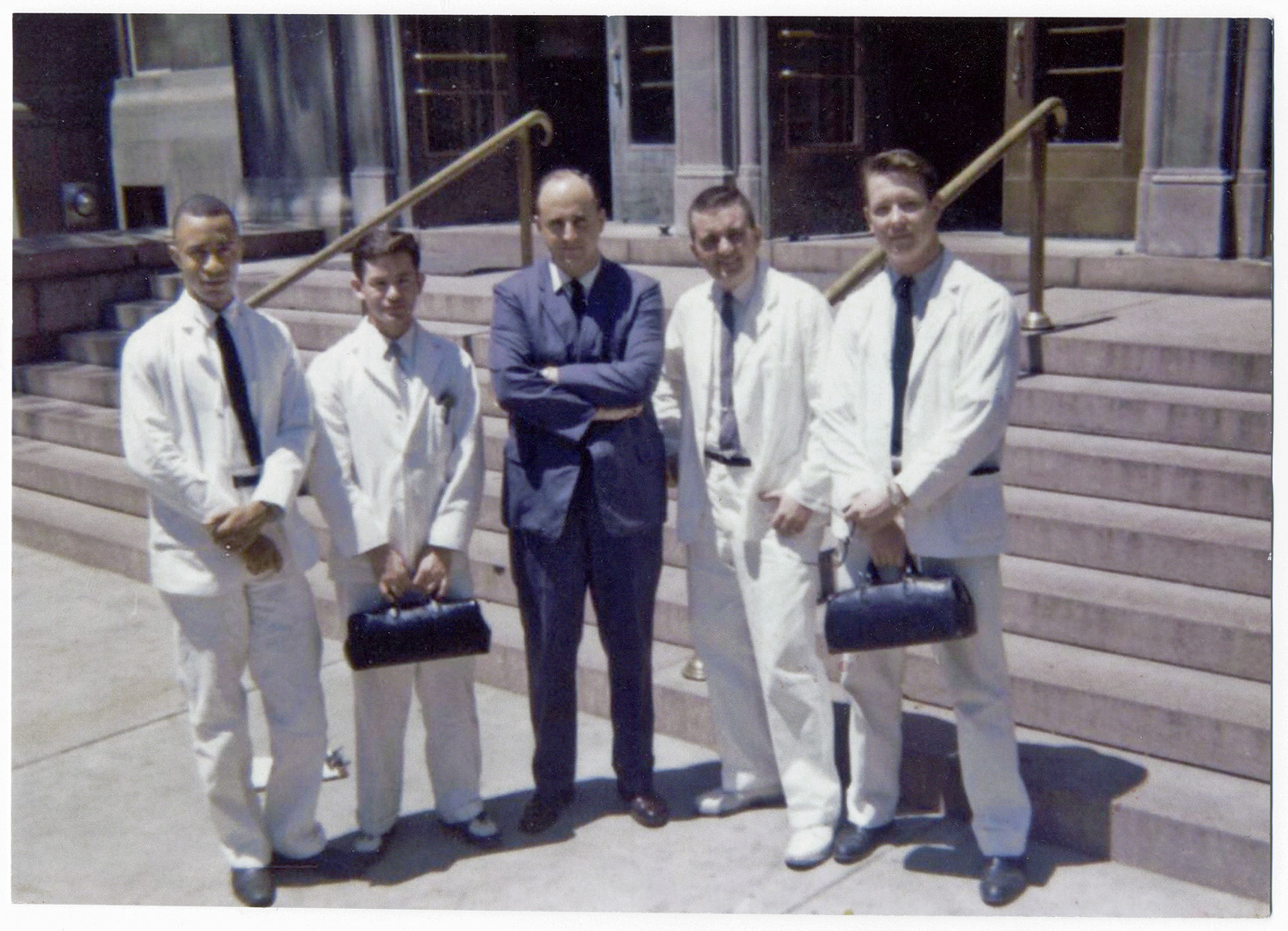 Medical rounds included ­working at Homer G. Phillips Hospital, then the city's black public hospital. From left, James L. Sweatt III is pictured outside the hospital in 1960 with fellow classmates Luis Vasconez, a doctor, John Stone and Ed Stewart. (Courtesy photo)