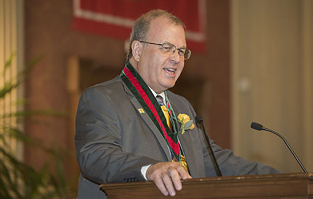 Lewis Wall speaks at installation ceremony