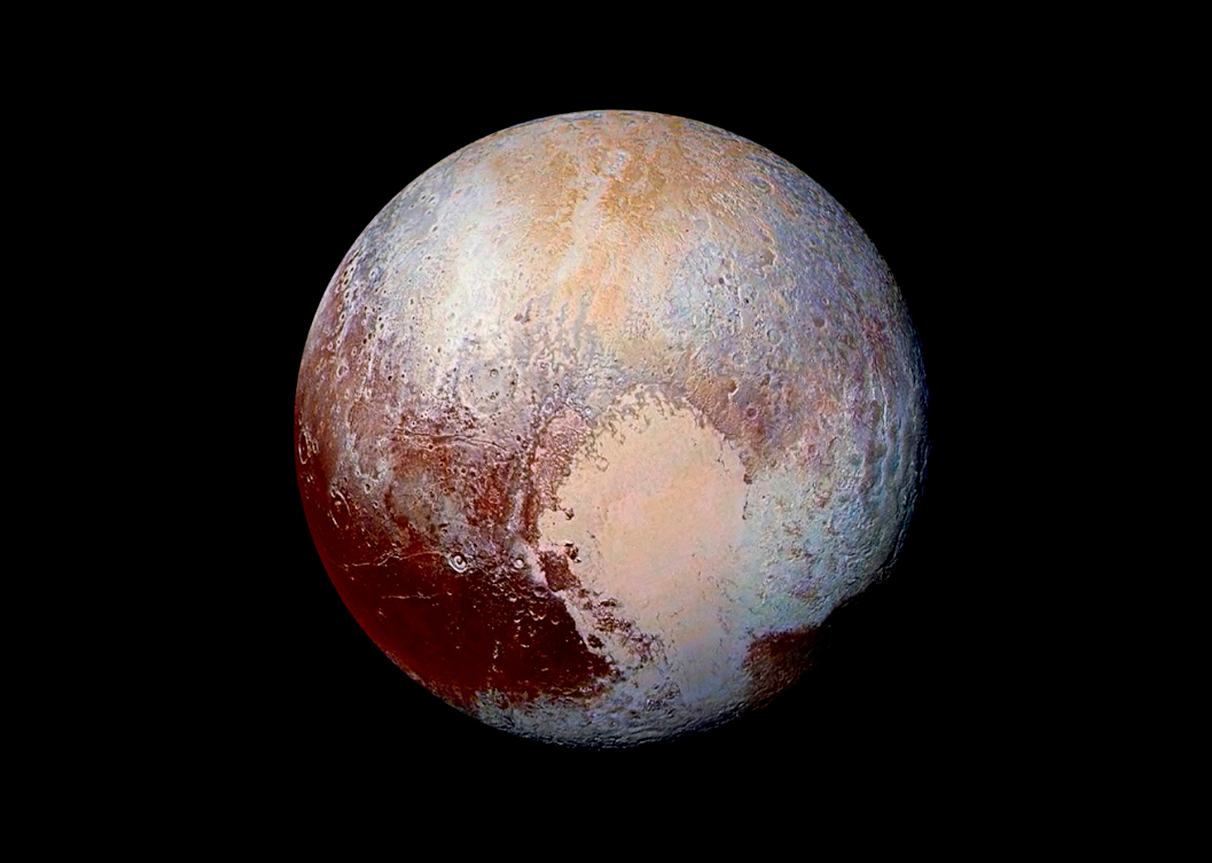 Pluto's surface sports a remarkable range of colors, enhanced in this view to a rainbow of pale blues, yellows, oranges and deep reds. (NASA/JHUAPL/SwRI)
