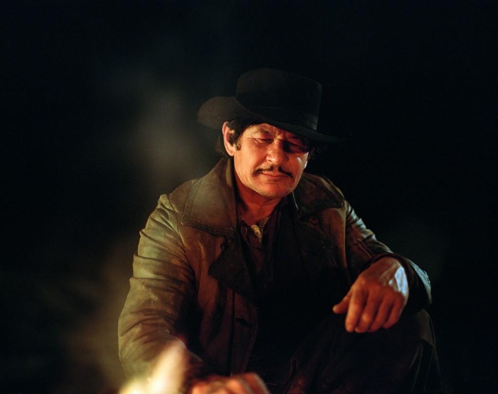Cowboy by campfire