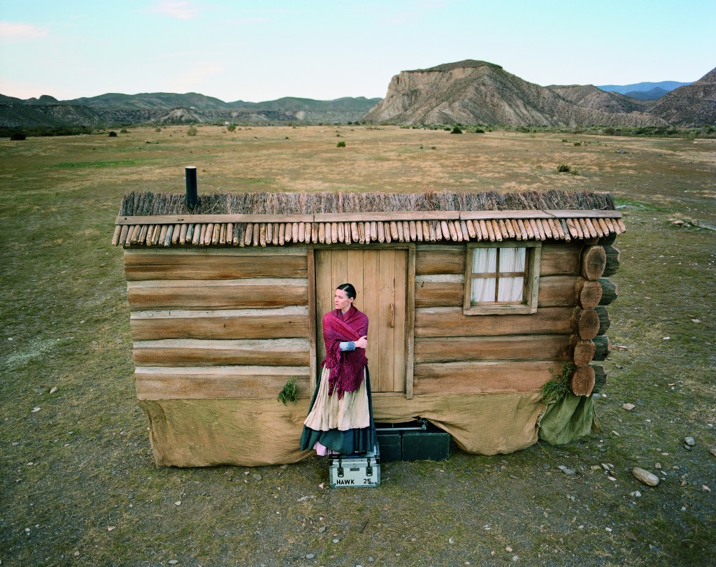 woman waiting by cabin